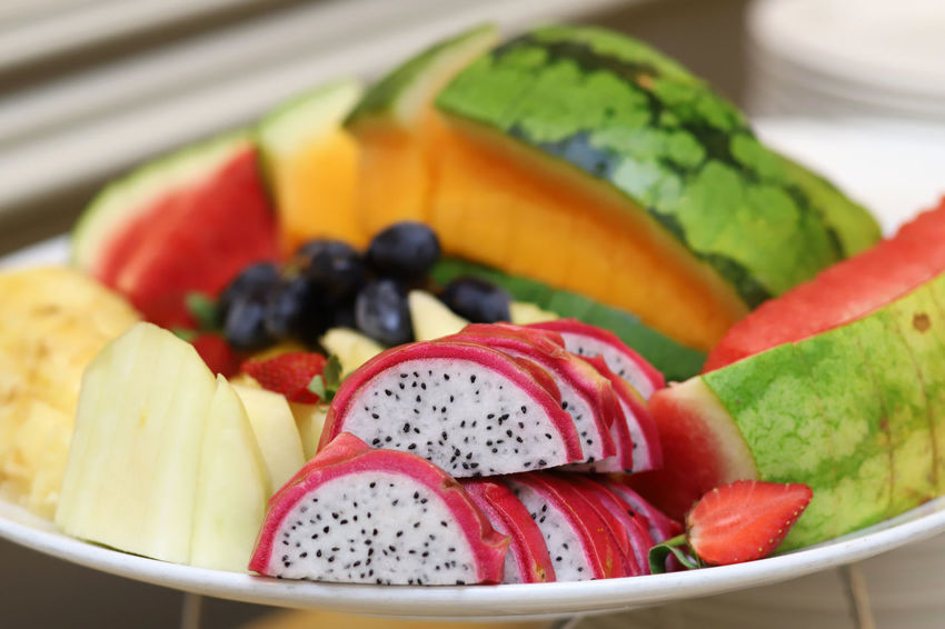 A plate of exotic tropical fruits Food Healthy Eating Fruit Wellbeing Freshness Berry Fruit Close-up Indoors  Bowl SLICE No People Still Life Choice Salad Pitaya Plate Focus On Foreground Variation Fruit Salad Ripe Temptation Tropical Fruit Grapes Watermelon