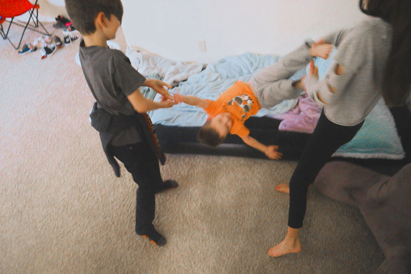 High angle view of people with toy on floor