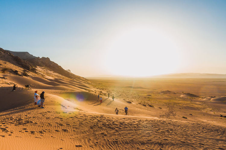 High angle view of people on desert against sky