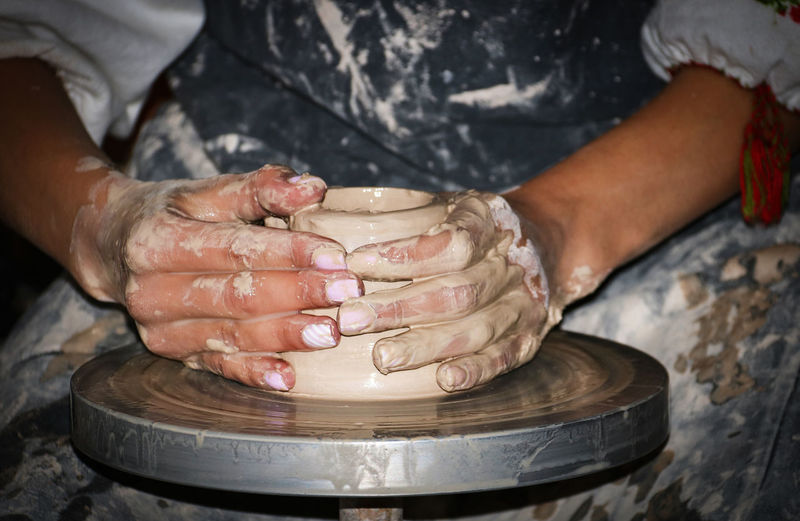 Ceramics Ceramics Studio Clay Clay Work Craft Creativity Expertise Hand Human Body Part Human Hand Indoors  Making Midsection Occupation One Person Potter's Wheel Pottery Preparation  Real People Skill  Spinning Working
