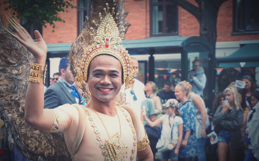A happy man Pride Parade Happiness Women Real People Group Of People Smiling Emotion Lifestyles Celebration Adult Portrait People Men Day Architecture Young Adult Leisure Activity Crowd Event Festival