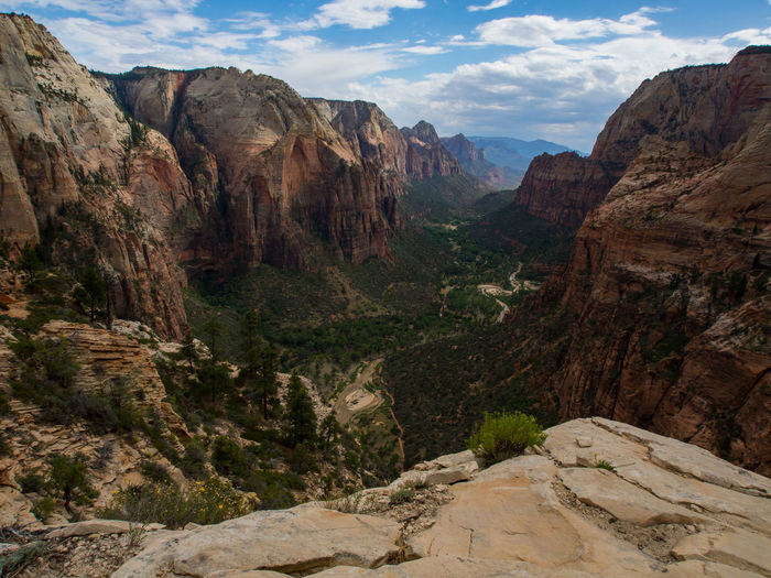 The view from the summit of Angels Landing in Zion National Park. Hiking Utah Zion Canyon Zion National Park Adventure Angels Landing Beauty In Nature Cliff Day Geology Landscape Mountain Mountain Range Nature No People Outdoors Overlook Physical Geography Rock Rock Formation Scenery Scenics Sky Tranquil Scene Travel Destinations