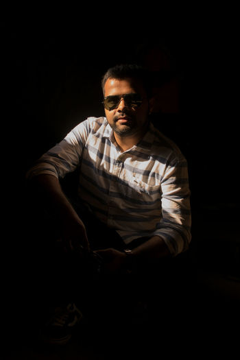 Portrait Sunglasses Black Background Portrait Men Chiaroscuro  Studio Shot Sitting Close-up Thoughtful Head And Shoulders Focus On Shadow Introspection Thinking Day Dreaming Shadow Redefining Menswear Exploring Fun