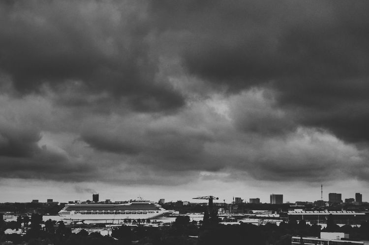 Not a good day for being on a cruise ship. Cruise Ship Amsterdam River View Clouds And Sky Skyline Black & White Contrast Rainy Days Ship
