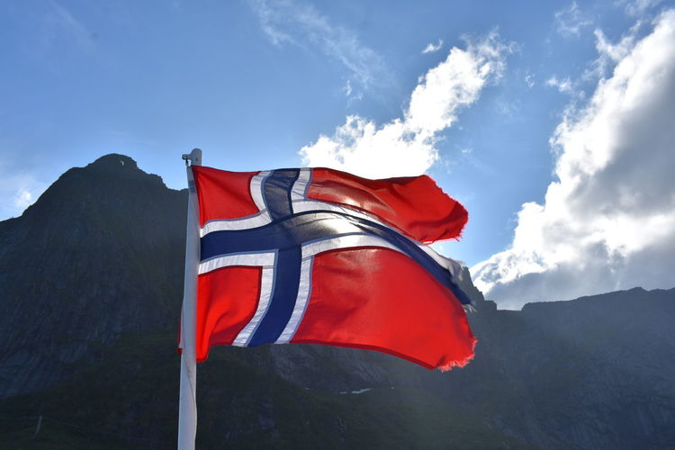 Low angle view of flag against mountain