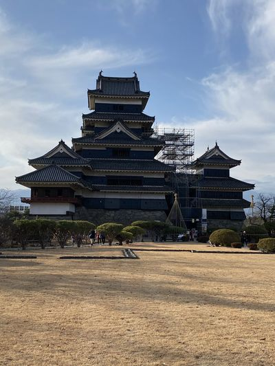 View of matsumoto castle against cloudy sky
