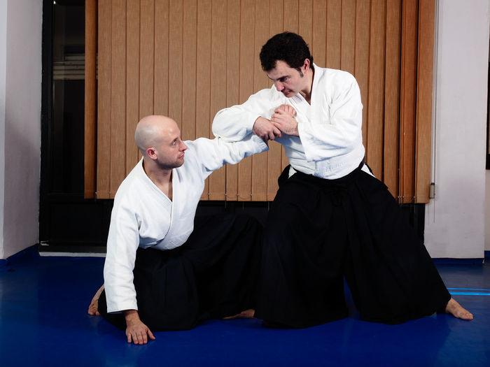 Men fighting on tatami mat