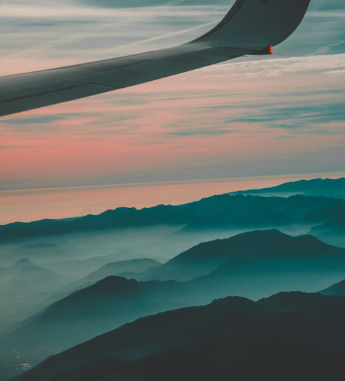 Air Vehicle Airplane Beauty In Nature Cloud - Sky Environment Idyllic Landscape Majestic Mode Of Transportation Mountain Mountain Range Nature No People Non-urban Scene Outdoors Scenics - Nature Sky Sunset Tranquil Scene Tranquility