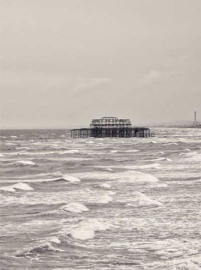 Old Brighton Pier, Brighton UK. Brighton Brighton Pier Brighton Pier UK Architecture Built Structure Day Horizon Over Water Nature Outdoors Sea Sky Water Waterfront Wave