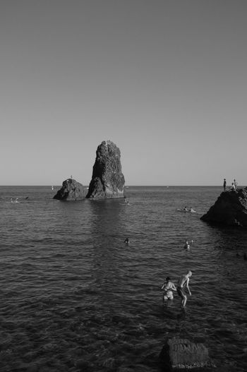 Acitrezza, Sicily Sea Water Nature Rock - Object Horizon Over Water Scenics Clear Sky Beauty In Nature Rock Formation Tranquility Tranquil Scene Idyllic Waterfront Sky Outdoors Day No People TheMinimals (less Edit Juxt Photography) Discover Italy / With Ale