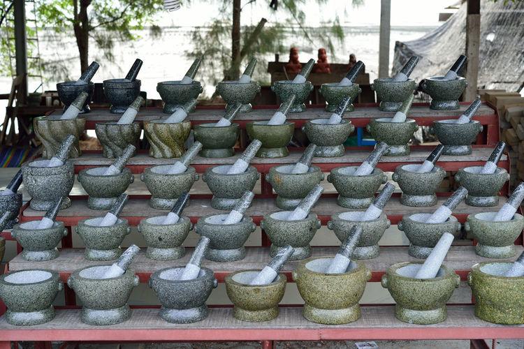 Mortar and pestles arranged at market stall