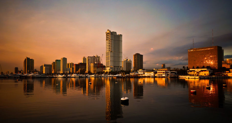 City Cityscape Illuminated Modern Reflection Skyscraper Sunset Travel Destinations Urban Skyline Waterfront