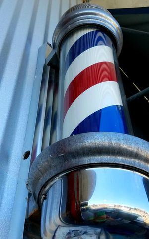 Barber Pole Blue Striped Low Angle View The Street Photographer - 2017 EyeEm Awards Copy Space Depth Of Field Pattern Strong Red White Blue Reflection Angle Low Angle View Wrapped Twirl Fun Timlessness Building Exterior