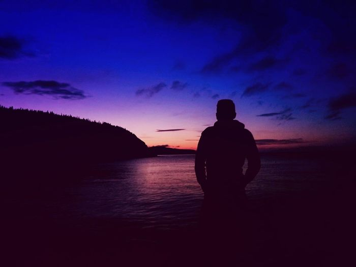 Sunset & Silhouette Silhouette Sunset Reflection Nature One Person Tranquility Outdoors Sky People Water Beauty In Nature Landscape One Man Only Scenics Night Ocean Horizon Over Water Beach