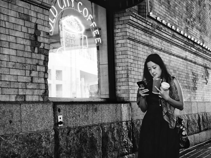 Priorities Real People One Person Young Women Young Adult Standing Built Structure Leisure Activity Lifestyles Women Adults Only Traditional Clothing Adult Only Women Architecture Outdoors Playing People Night Saxophone Philadelphia Downtown Portrait Straightfromcamera Fujifilm_xseries Information Sign Handwriting