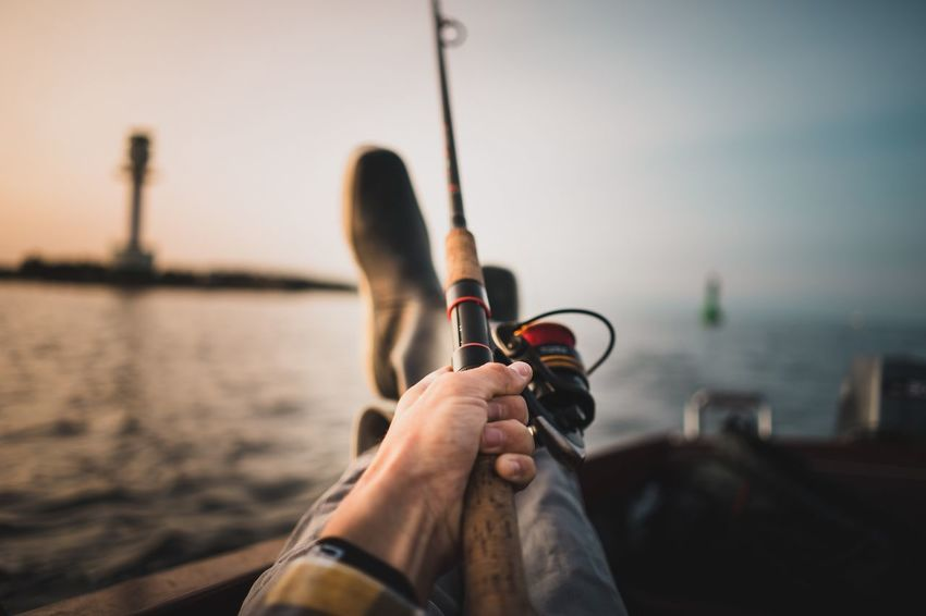 Fishing at sunset Activity Hobby Fisher Men Captain Rubber Boots Outdoors Ocean Fishing Maritime Marine Real People One Person Focus On Foreground Human Body Part Low Section Personal Perspective Men Human Leg Human Hand Beach Water Outdoors Sea Leisure Activity Day Lifestyles Sky Standing Close-up Nature Fresh On Market 2018