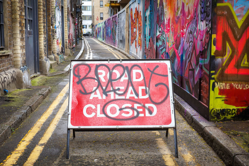 Architecture Building Exterior Built Structure City Damaged Day Graffiti No People Outdoors Road Closed Road Sign Text