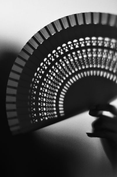 fan in a womens hand Indoors  Technology Lighting Equipment Illuminated No People Close-up Architecture Day Fächern Blackandwhite Kontrast Light And Shadow Structure