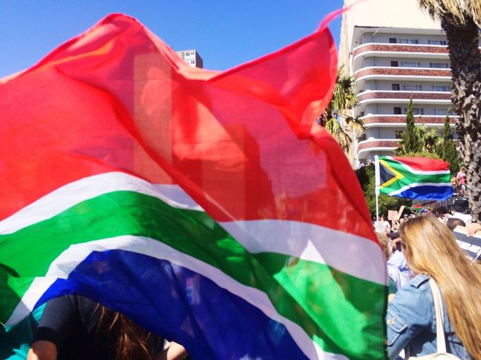 Protest marches in Cape Town South Africa to fire our ex State President South Africa Crowds Of People Protesters Protests United People Unification Mass Protest March Together Flag Multi Colored Group Of People Day People Adult The Photojournalist - 2018 EyeEm Awards Real People Women Patriotism Textile Sunlight Outdoors Sky Pride Incidental People Crowd Emotion National Icon