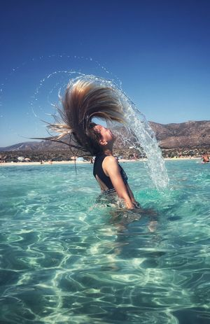Water One Person Lifestyles Leisure Activity Real People Motion Splashing