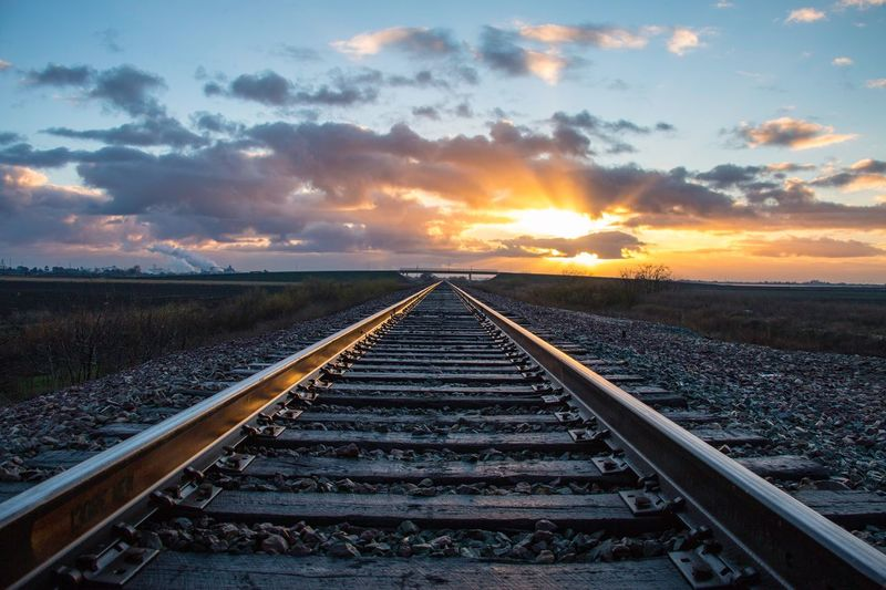 Railroad Track Rail Transportation Sunset Transportation Sky Scenics Nature Cloud - Sky Beauty In Nature Railroad Tie No People Tranquil Scene Outdoors Sunlight Landscape Tranquility The Way Forward Day