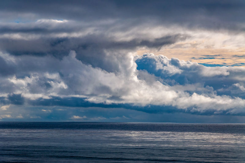 Sunset Cliffs Natural Park and Plant Preserve looking out over a dramatic stormy sky over the ocean. Cloud - Sky Sky Sea Water Horizon Over Water Beauty In Nature Scenics - Nature Horizon Tranquil Scene Tranquility Nature No People Outdoors Storm Idyllic Waterfront Dramatic Sky Day Ominous Power In Nature