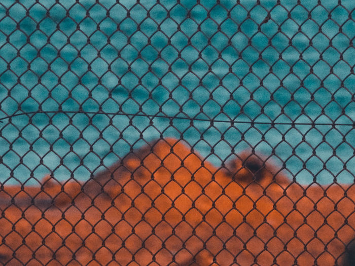 Full frame shot of chainlink fence with swimming pool