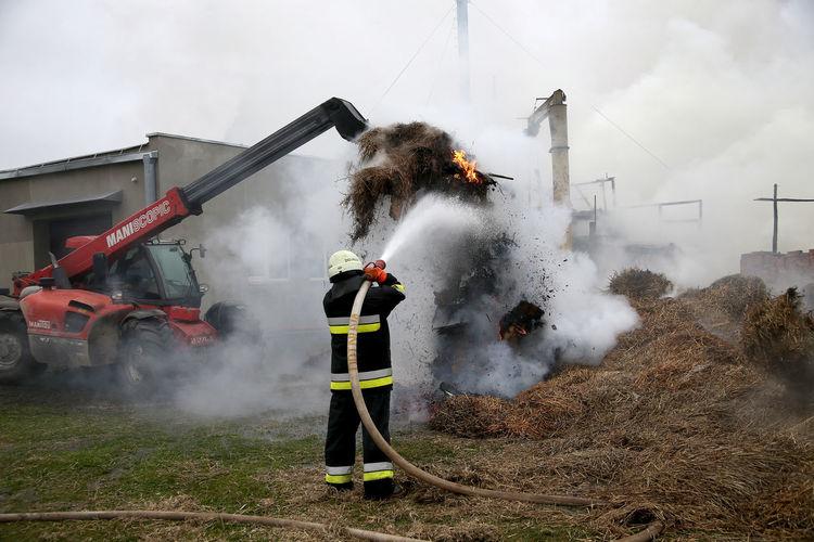 Man working on smoke emitting from camera
