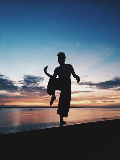 Full Length Of Silhouette Dancer Dancing By River Against Sky