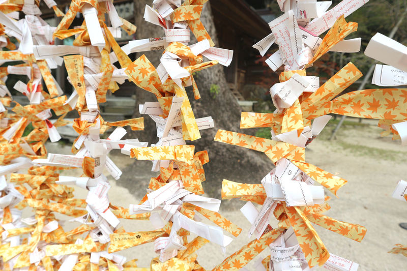 Full frame shot of patterned tied hanging outside temple