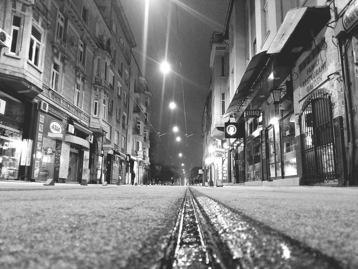 the tram rail POV perespective Bw BW_photography Urban Culture  Streetwise Photography City Illuminated Railroad Track Street Light Street Architecture Building Exterior Built Structure Sky vanishing point The Way Forward Railroad Tie Pathway Walkway Narrow Long Passageway Road Marking Rail Transportation Tramway Railway Track Empty Road Alley Diminishing Perspective Treelined