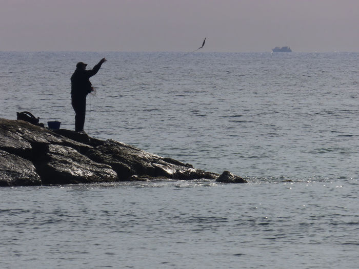 Adult Beauty In Nature Day Fisherman Throwing Bait Horizon Over Water Men Nature One Man Only One Person Outdoors People Sea Silhouette Water
