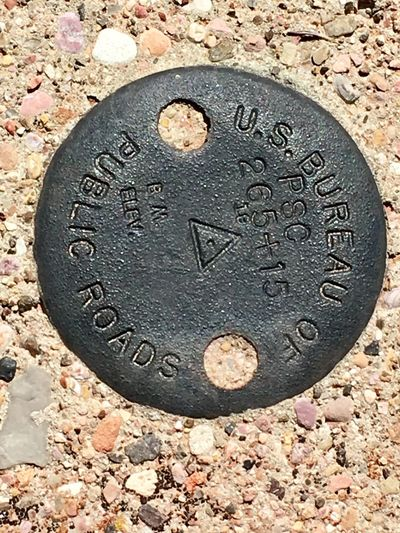 Road survey marker Government Public Road Finance Circle No People Close-up Communication Day Gravestone Outdoors Weathered Survey Marker Survey Road Road Marking Landmark Roadtrip Marker Physical Geography Metal Aged History Iron This Week On Eyeem Eye4photography  Sommergefühle