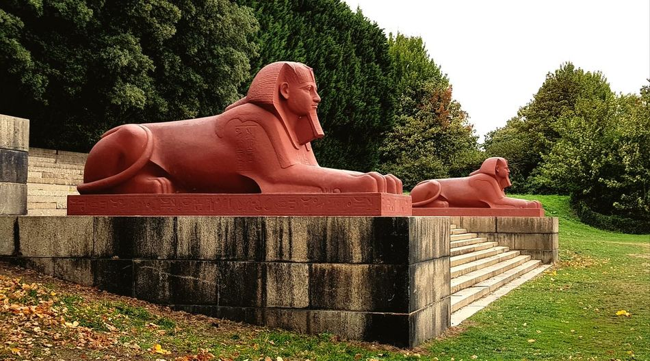 The Sphinxes Urban Urban Landscape Look Out Overlook Pharoah Lion Orange Color Orange Egyptian Crystal Palace Park London Park Statue Sphinx Victorian Red Red Ochre Public Art EyeEm Selects Sculpture Idol Representing Male Likeness