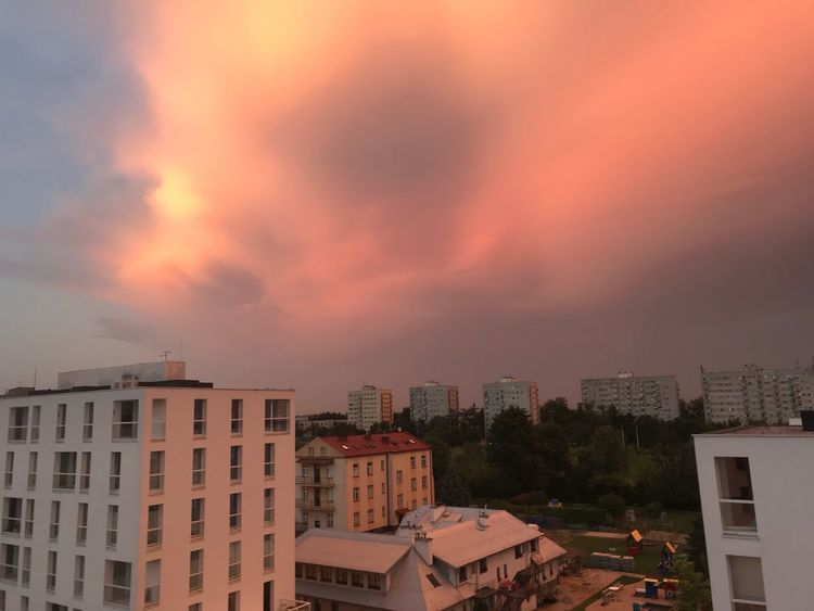 Glowing evening sky over the city Building Exterior Architecture Built Structure Sky Sunset Building Cloud - Sky City Residential District Orange Color No People Nature Cityscape High Angle View Dramatic Sky Outdoors Roof