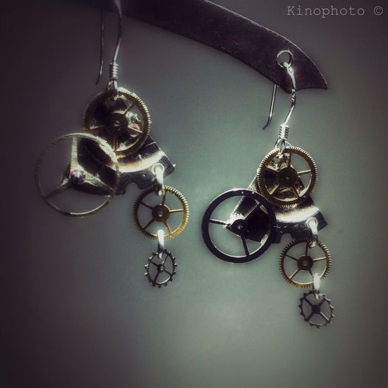Steampunk Jewelry Gears Design Handmade earrings created with parts of vintage watches. Design by Kino, Paris.