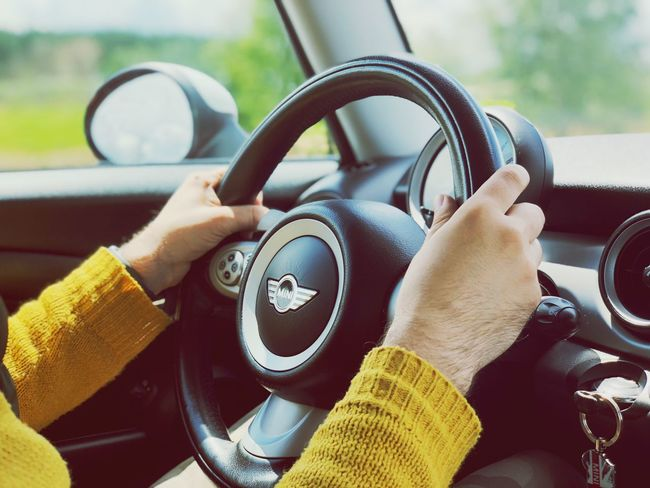 EyeEm Selects Motor Vehicle Car Human Hand Hand Mode Of Transportation One Person Dashboard Holding Women Human Body Part Transportation Lifestyles Vehicle Interior Car Interior Land Vehicle Driving Steering Wheel Adult Body Part Real People