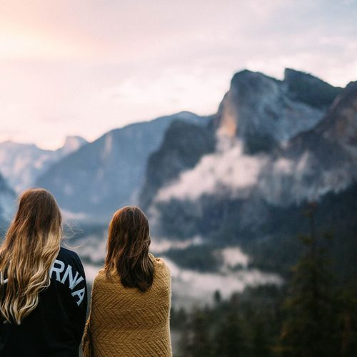 Mountain Rear View Real People Togetherness Two People Nature Leisure Activity Mountain Range Lifestyles Bonding Women Scenics Beauty In Nature Vacations Focus On Foreground Cold Temperature Adventure Men Winter Headshot