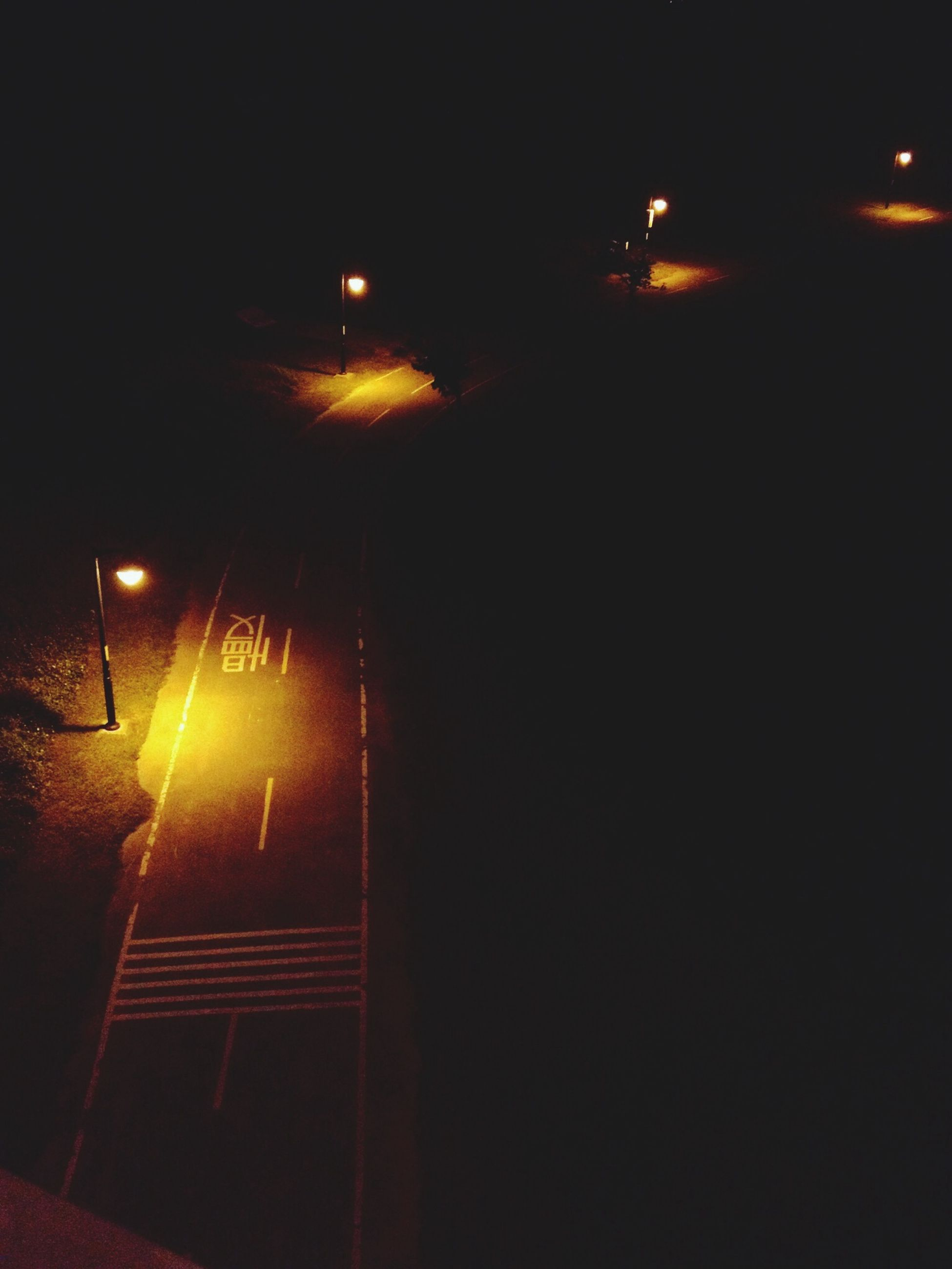 illuminated, night, lighting equipment, street light, dark, light - natural phenomenon, electric light, transportation, glowing, the way forward, lit, indoors, no people, electricity, built structure, street, light beam, road, copy space, low angle view