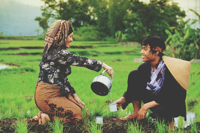 My love is in the field Human Interest Praweddingphotography Prawedding Togetherness Friendship Men Playing Full Length Smiling Happiness Moments Of Happiness