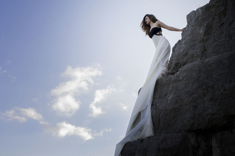 A second before jumping. Jump High EyeEm Selects Young Women Bride Beauty Climbing Women Full Length Females Standing Sky Countryside Posing EyeEmNewHere