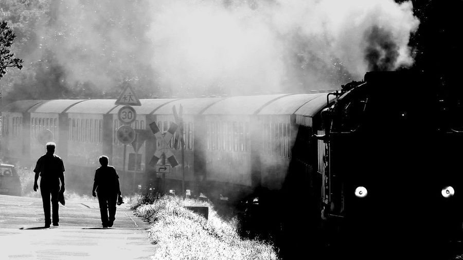 Black And White Couple People Railroad Smoke Steam Locomotive Train Walking
