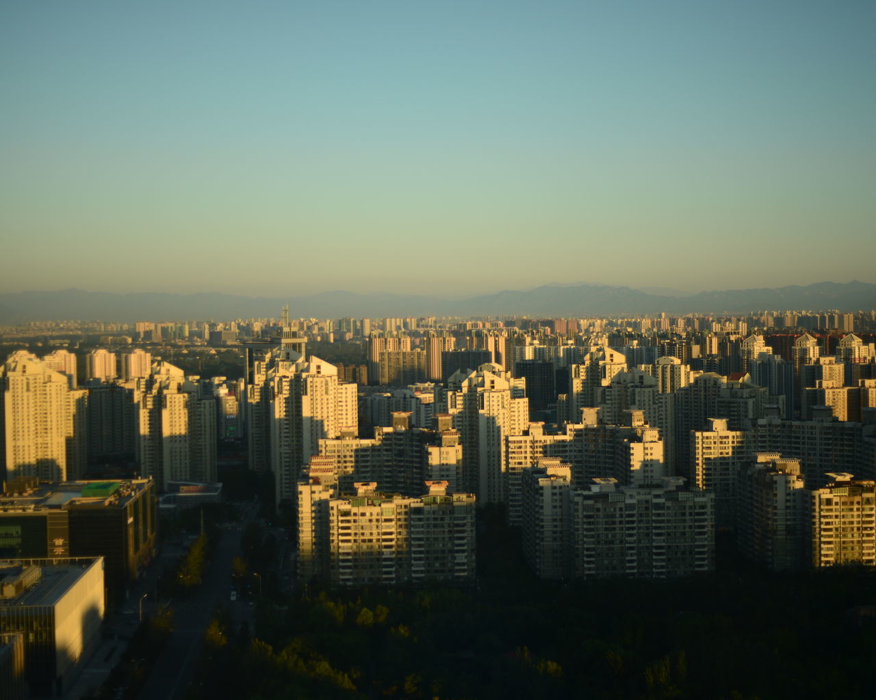 High Angle Shot Of Cityscape Against Clear Blue Sky