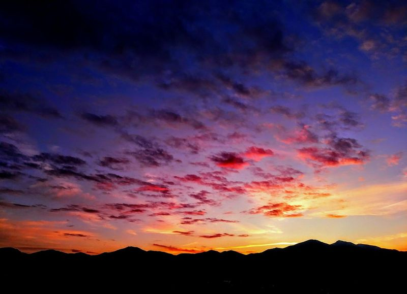 Sunset over the Oquirrh Mountains, West Jordan, Utah. Sunset Silhouette Dramatic Sky Mountain Landscape Sky Nature Multi Colored Scenics Night Outdoors No People Tree Beauty In Nature