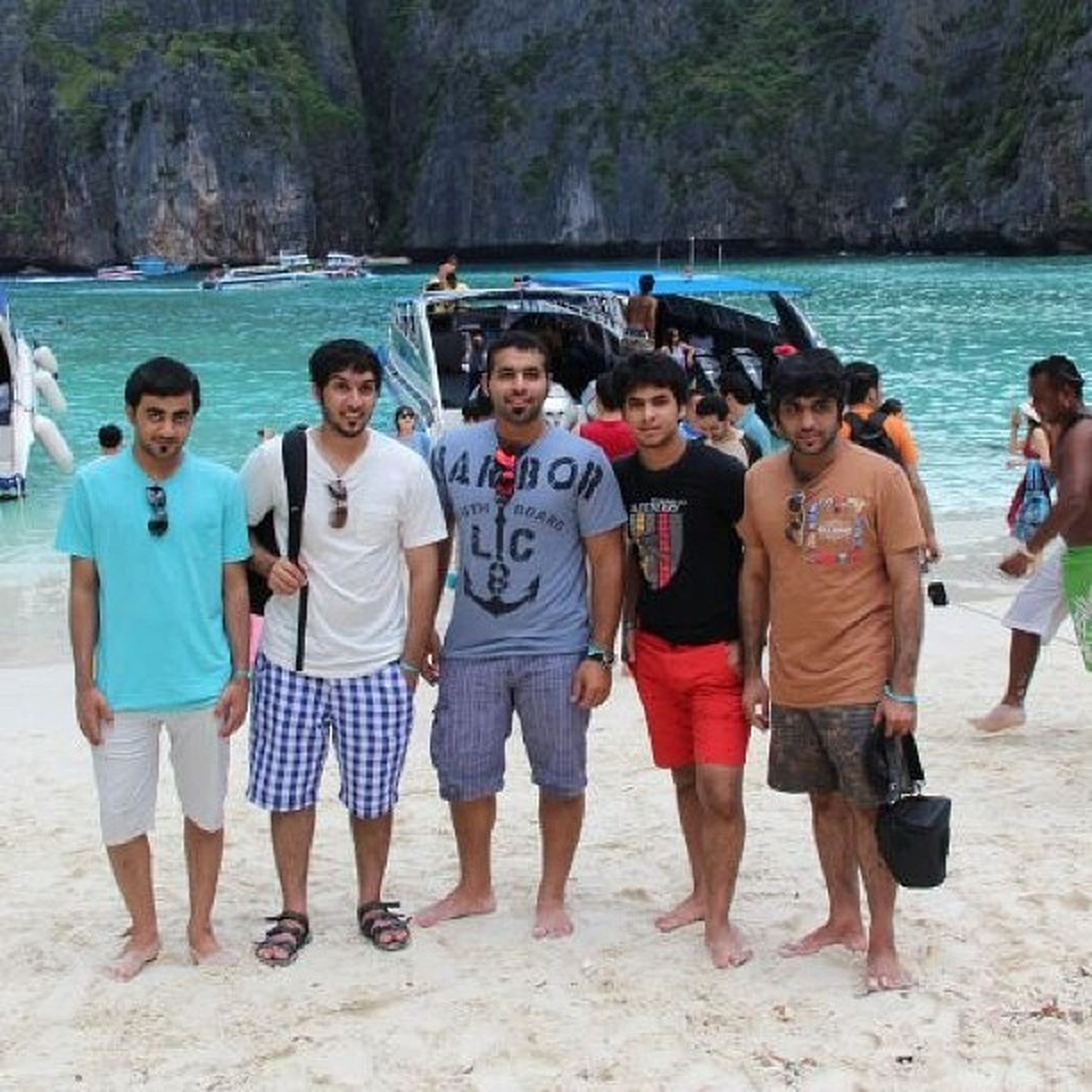 lifestyles, togetherness, leisure activity, water, bonding, friendship, vacations, casual clothing, love, enjoyment, men, large group of people, standing, person, beach, full length, young men, sea