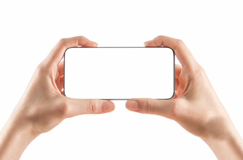 Low angle view of mobile phone against white background