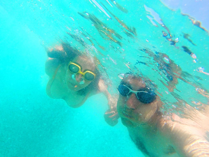Underwater photo of a young couple holding their breath during swimming in the sea Lovers Man Snorkeling Summer Vacation Beach Bubble Couple - Relationship Eyewear Girl Leisure Activity Lifestyles Nature Ocean Outdoors Portrait Real People Sea Sport Swimming Swimming Pool Turquoise UnderSea Underwater Underwater Diving Water