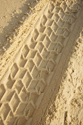 tracks on a sandy beach - closeup - in warm sunlight 4x4 Arid Climate Backgrounds Beach Car Close-up Desert Full Frame Imprint Jeep Land Vehicle Nature No People Offroad Outdoors Pattern Sand Sand Dune Sandy Sandy Beach Sunlight Tire Track Trace Track Tread