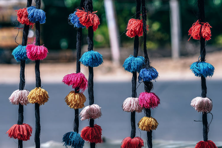 Adorable Cotton Puffs Hair Bands Hanging Hanging Out Pink Adorable Beauty In Nature Buyer Buyers And Sellers Cart Carts Close-up Color Cotton Day Focus On Foreground Knit Hat Multi Colored No People Outdoors Pink Color Puff Puffs Roadside Selling Vendor