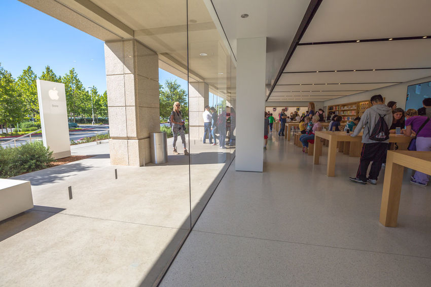 Cupertino, California, United States - August 15, 2016: the Apple world headquarters at One Infinite Loop. Apple is a multinational that produces consumer electronics, personal computers and software. people come from the popular Apple store of Apple Inc Headquarters at One Infinite Loop located in Cupertino, Silicon Valley, California. Apple California IT Mac PC United States Architecture Building Built Structure Computer Cupertino Day Electronics Industry Flag Headquarter Headquarters Hq IMac27 IPhone Imac Indoors  Infinite Loop Large Group Of People Mobile Modern People Real People Sky Store